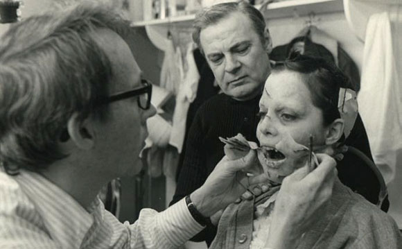 Make-up artist Dick Smith works with Linda Blair on the set of The Exorcist (1973)