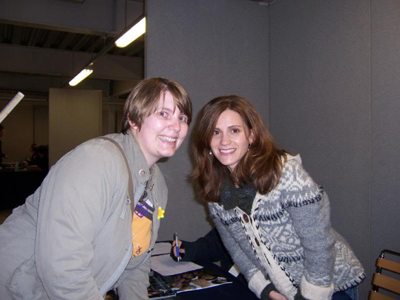 Kerri Green poses with a fan at a Showmasters event in 2009
