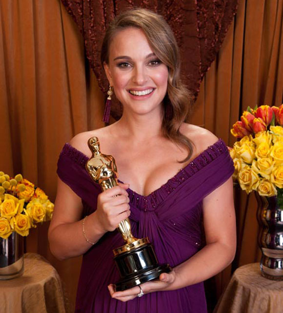 "Natalie Portman with her ""false idol"" Oscar Award"